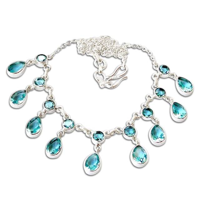 silver necklace with gleaming blue topaz crystals