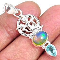 5.24cts natural ethiopian opal oval blue topaz 925 silver angel pendant r75449