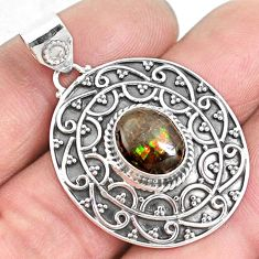 4.38cts natural multi color ammolite (canadian) 925 silver pendant p33437
