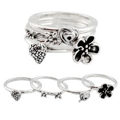 8.89gms stackable charm rings 925 silver flower 4 rings size 7.5 c7697