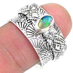 0.71cts solitaire natural ethiopian opal 925 silver spinner ring size 7.5 t31454